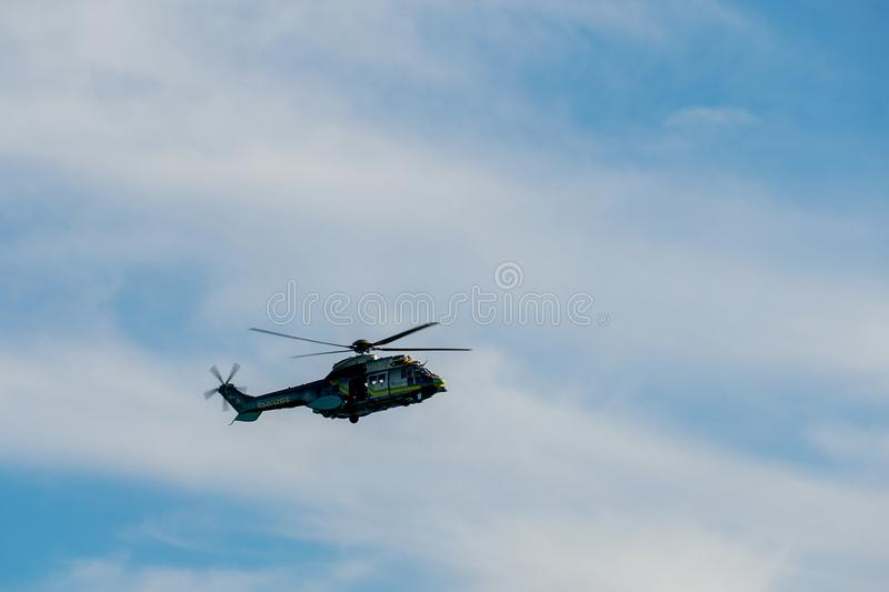 Sheriff Helicopter Hovering on a Beautiful Sky Background. Sheriff Department helicopter on a routine surveillance mission in Santa Monica. Los Angeles royalty free stock photo