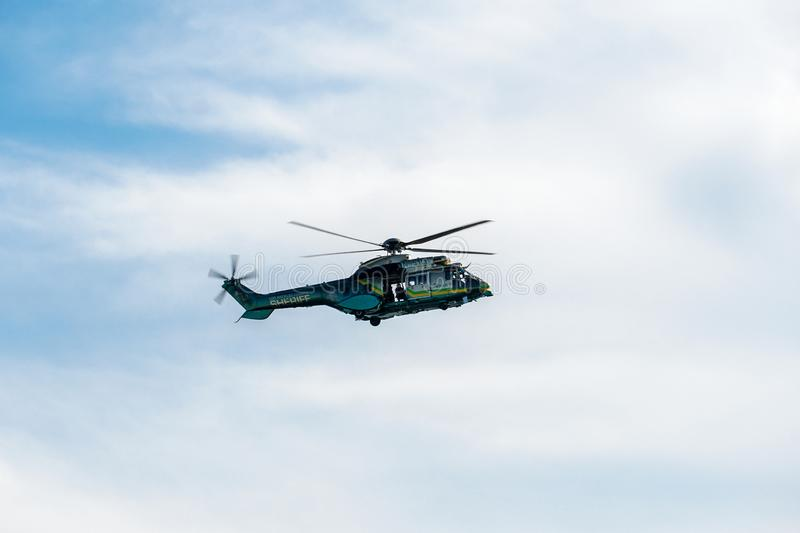 Sheriff Helicopter Hovering on a Beautiful Sky Background. Sheriff Department helicopter on a routine surveillance mission in Santa Monica. Los Angeles royalty free stock images