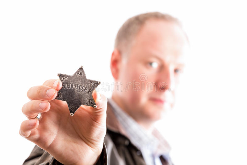 Sheriff of old times. Sheriff presents his sheriff star badge isolated on white stock photo