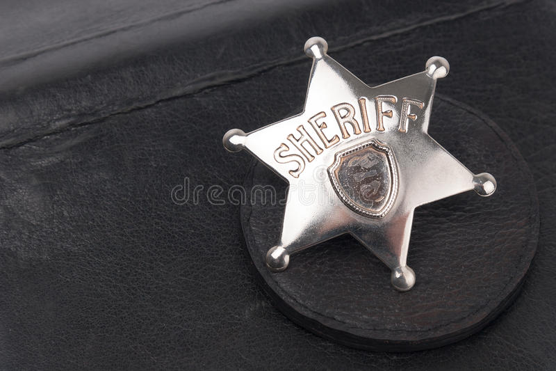 Sheriff's badge on dark royalty free stock photos