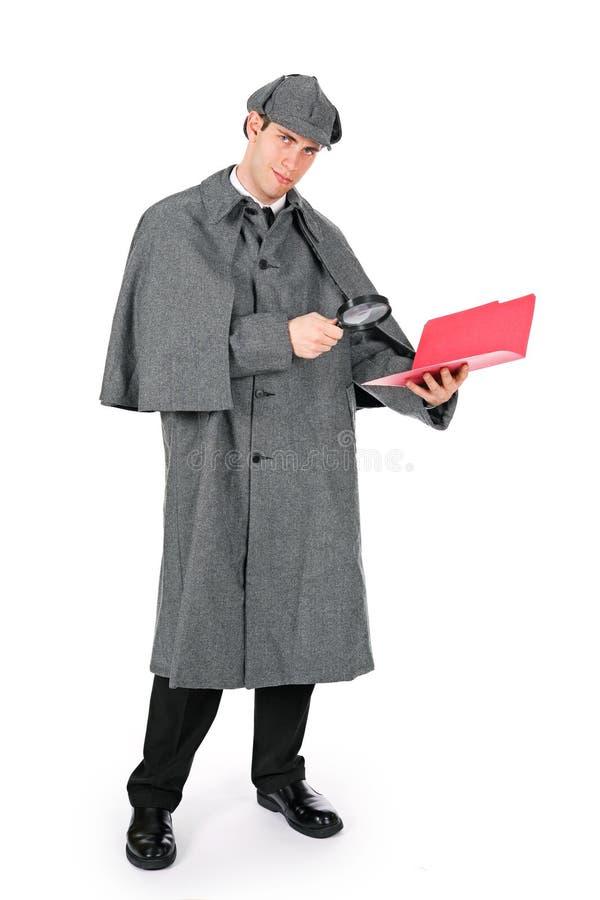 Sherlock: Сыщик находит секрет в документах стоковые фото