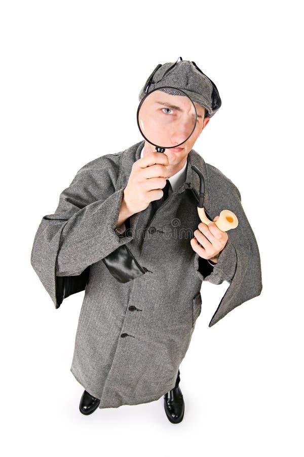 Sherlock: Фокус на глазе сыщика через лупу стоковые изображения
