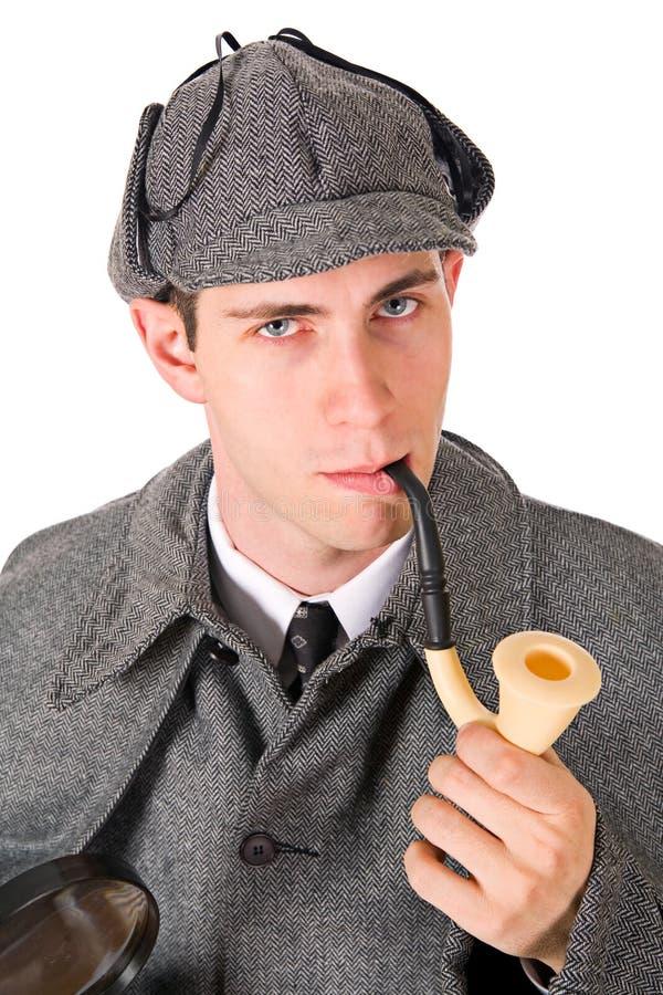 Sherlock: Человек с серьезным взглядом и трубой стоковое изображение rf