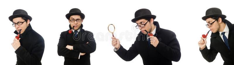 Sherlock Holmes con el tubo que fuma aislado en blanco imagenes de archivo