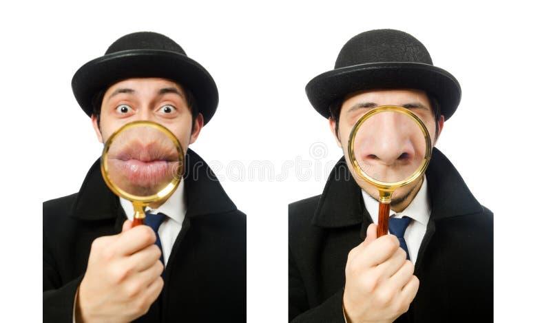 Sherlock Holmes con la lupa aislada en blanco imagen de archivo libre de regalías