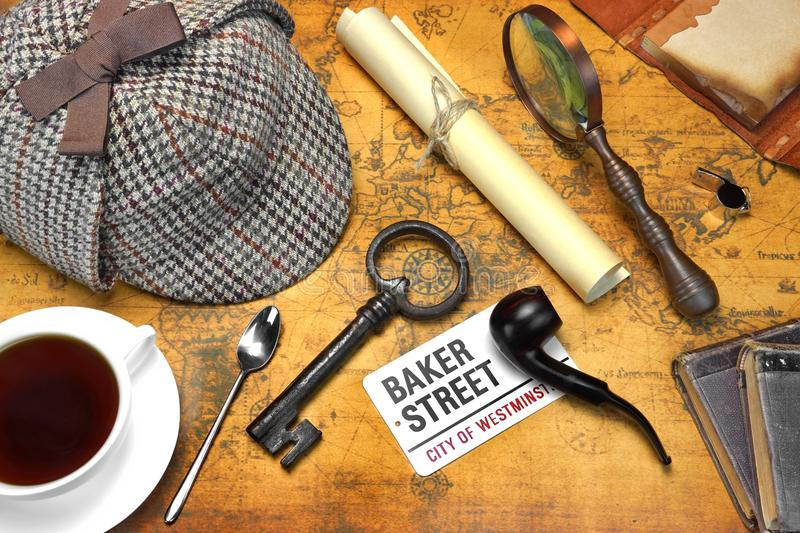 Sherlock Holmes Deerstalker Cap And Other Objects On Old Map. Private Investigation Concept. Sherlock Holmes Deerstalker Cap, Full Teacup, Sign BAKER STREET stock photography