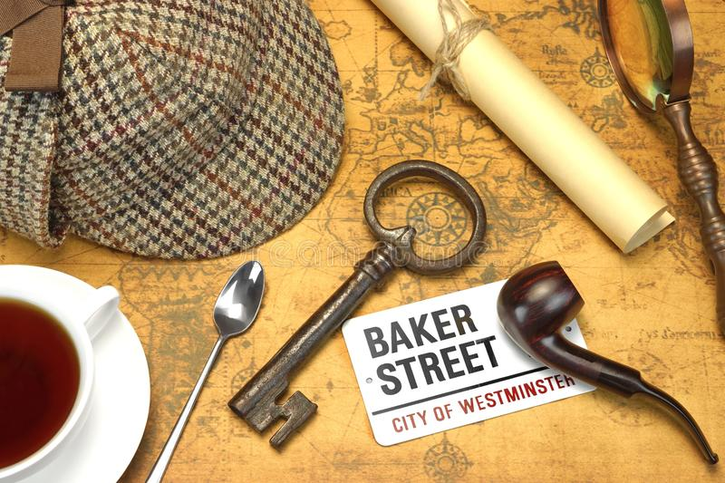 Sherlock Holmes Deerstalker Cap And Other Objects On Old Map. Private Investigation Concept. Sherlock Holmes Deerstalker Cap, Full Teacup, Sign BAKER STREET royalty free stock photo