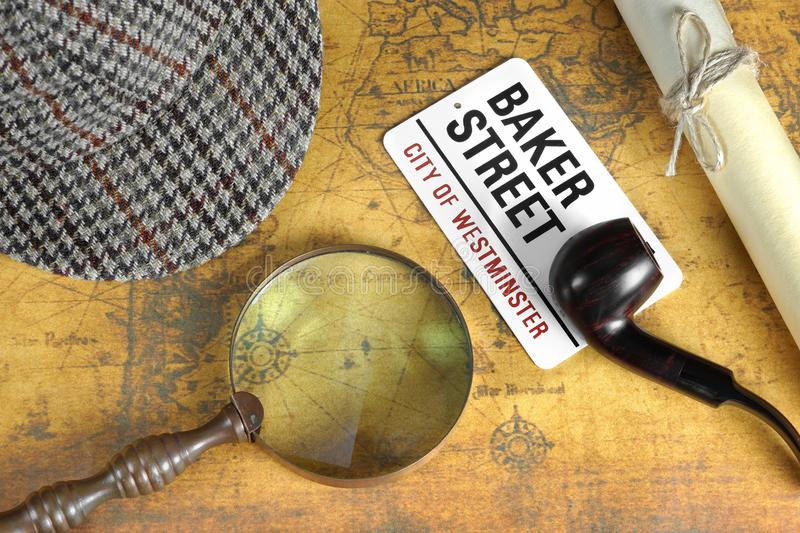 Sherlock Holmes Deerstalker Cap And Other Objects On Old Map. Private Investigation Concept. Sherlock Holmes Deerstalker Cap, Sign BAKER STREET, Roll Of Paper stock photography