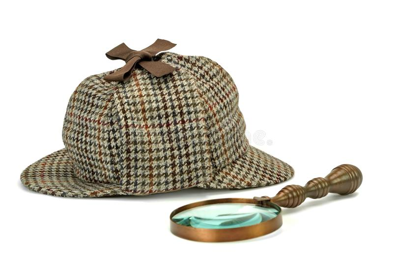 Sherlock Holmes Deerstalker Cap And Vintage Magnifying Glass Iso. Lated On White Background. Investigation Concept stock photos