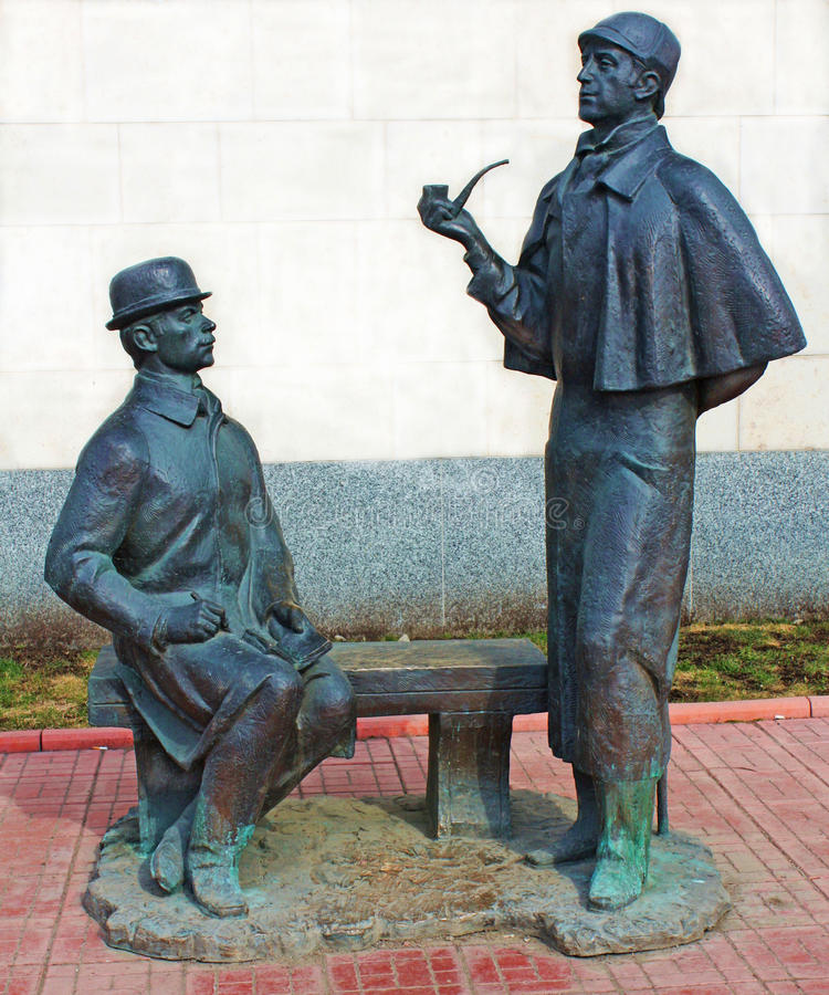 Sherlock Holmes and dr. Watson, Moscow. Monument to heroes of book by Arthur Conan Doyle Sherlock Holmes and doctor Watson near British Embassy in Moscow, built stock images