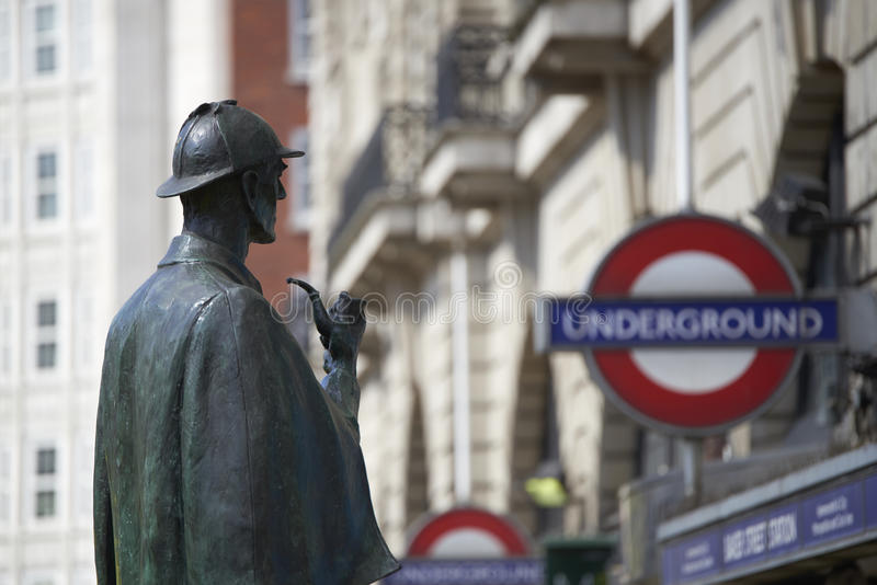 Sherlock Holmes. LONDON, UK - APRIL 22: Bronze statue of Sherlock Holmes in front of Baker Street station. April 22, 2015 in London. The statue was commissioned royalty free stock image
