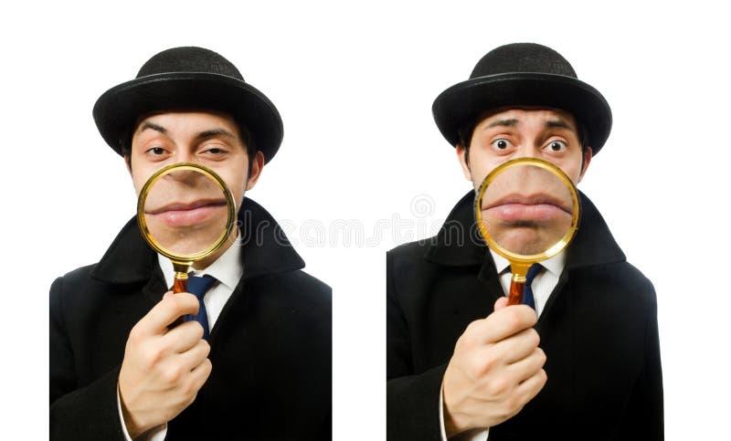 Sherlock Holmes met vergrootglas op wit wordt ge?soleerd dat stock foto
