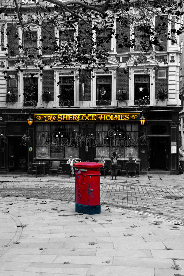 Sherlock Holmes. A picture of a very British red post box in from of the famous Sherlock Holmes bar/pub royalty free stock photography