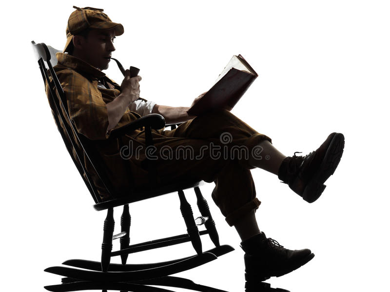 Sherlock holmes reading silhouette. Sitting in rocking chair in studio on white background stock photography