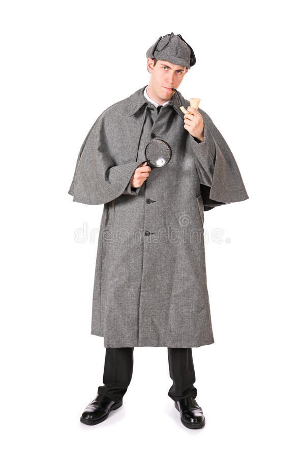 Sherlock: Man As Sherlock Holmes with Magnifying Glass and Pipe. Man dressed as detective Sherlock Holmes royalty free stock images