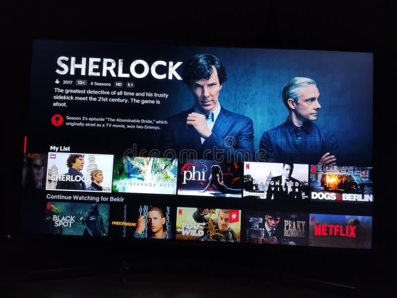Sherlock - Netflix television screen with popular series choice. Movies. Netflix internet television with popular TV series menu. Modern media and broadcasting royalty free stock photo