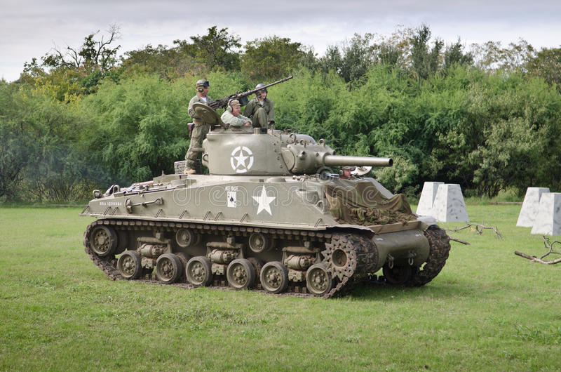 Sherman tank in historical reenactment of WWII. Old Sherman tank and American men dressed up as American troops in historical reenactment of WWII in Austin,Texas royalty free stock photo