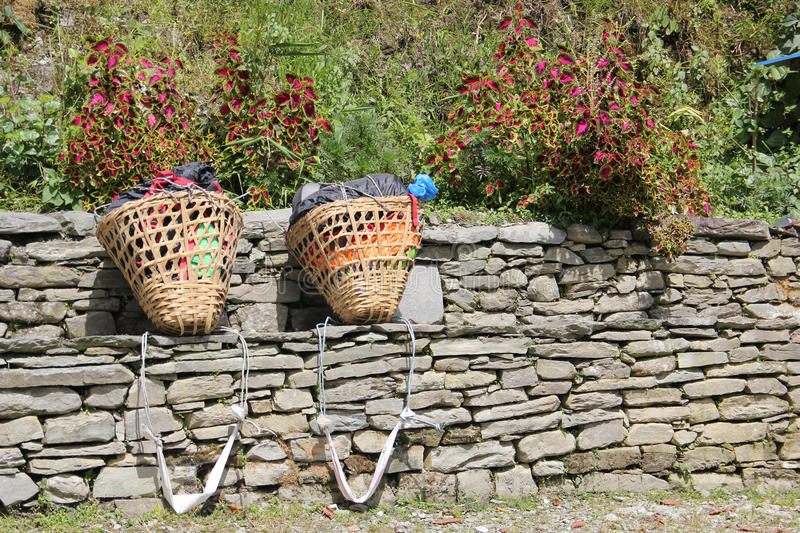 Sherpa porters backpacks. Near the village of Ghorepani , Nepal. Ghorepani is a village in Myagdi District in the Dhawalagiri Zone of northern-central Nepal royalty free stock image