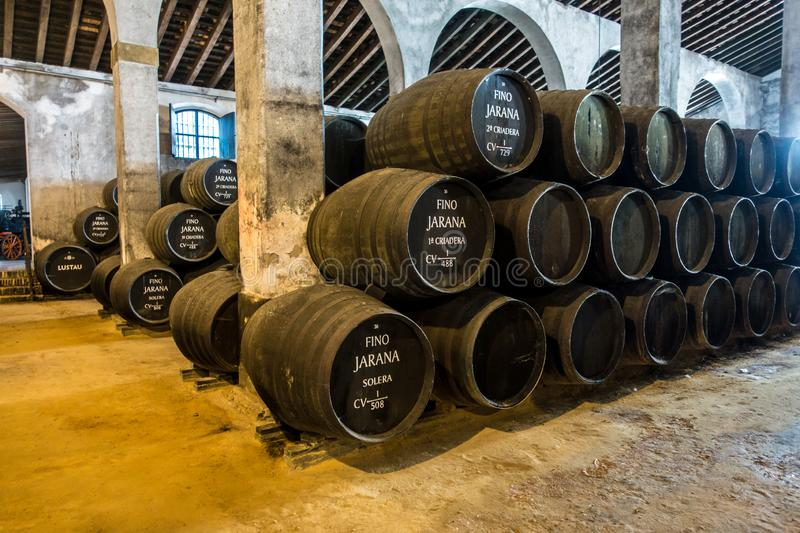 Sherry barrels in a bodega in spain stock images