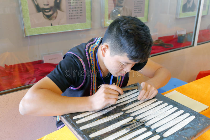 Shes`s craftsman made silverware. Shezu craftsman make silverware, fuan city, fujian province, china. shes is the most populous ethnic minority in fujian royalty free stock photos