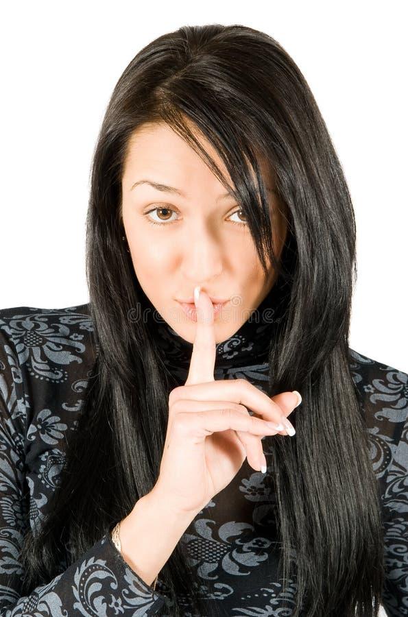 Shh. Geheimnis - junge schöne Frau lizenzfreie stockbilder