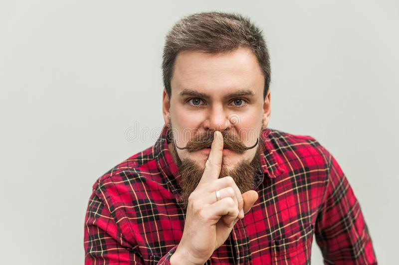 Shh sign. Anger businessman with beard and handlebar mustache royalty free stock photography