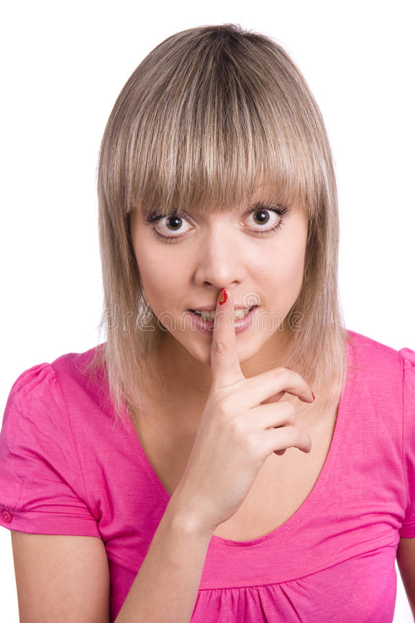 Shhh... Young Woman With Her Finger On Lips. Royalty Free Stock Photos