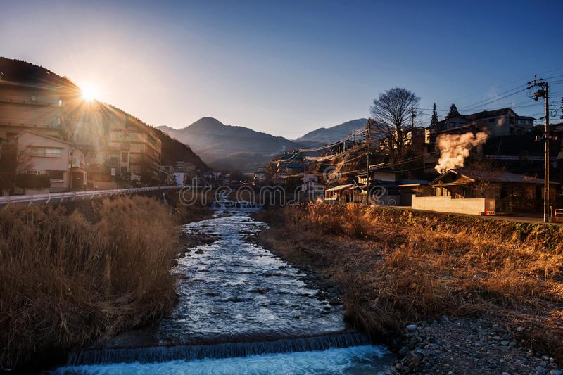 Shibu onsen cityscape town at sunrise. Shibu onsen cityscape or landscape with cascading water river at sunset, Yamanouchi, Nagano, Japan. The town is famous for royalty free stock image