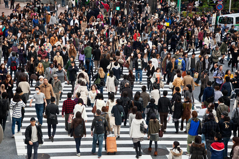 Shibuya Crossing. Pedestrians at Shibuya Crossing in Tokyo, Japan. The intersection is one of the busiest and most famous scramble crosswalks in the world