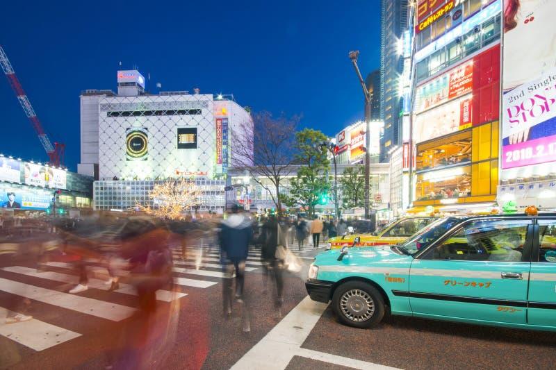 SHIBUYA, JAPAN - FEBRUARI 19, 2016: groen de taxipark van Japan op t stock afbeelding