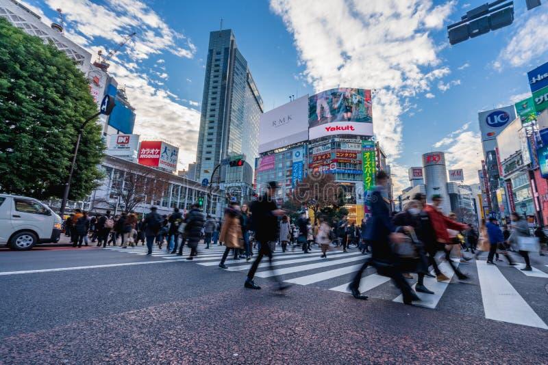 Shibuya, Tokyo, Japan - December 26, 2018: Crowd pedestrians people walking on zebra crosswalk at Shibuya district in Tokyo, Japan. In the morning. Famous stock photo