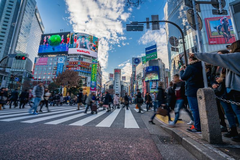 Shibuya, Tokyo, Japan - December 26, 2018: Crowd pedestrians people walking on zebra crosswalk at Shibuya district in Tokyo, Japan. In the morning. Famous royalty free stock image