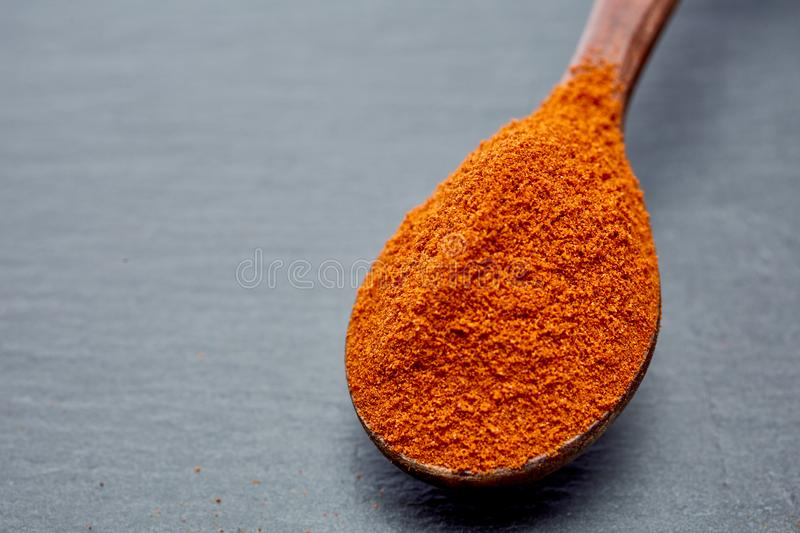 Shichimi pepper in Wooden spoon on black plate, stock images