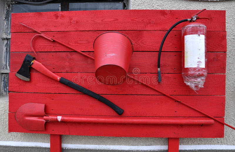 Shield of Fire Extinguishing Fire_2. Fire Shield which placed primary means for extinguishing a fire and a box of sand stock image