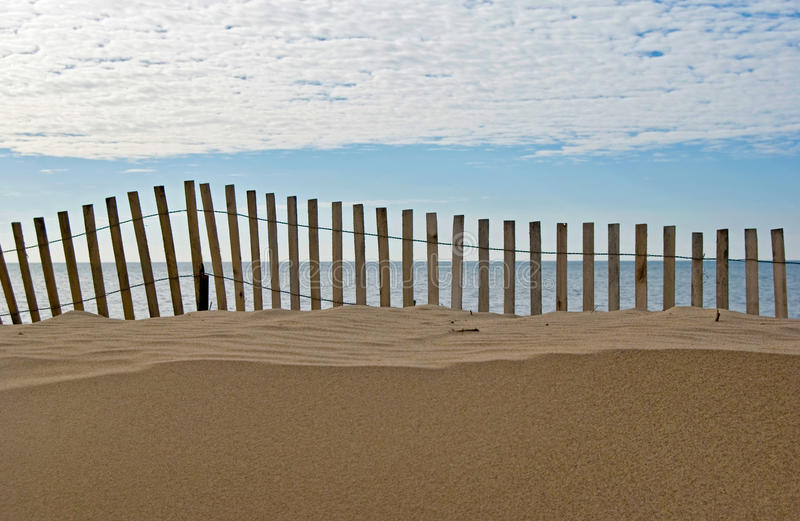 Shifting Sands. Old snow fence on a Lake Michigan beach royalty free stock photo