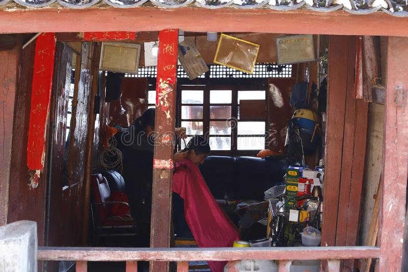 A hairdresser barber shop along the street in the village of Shigu, Yunnan, China stock image