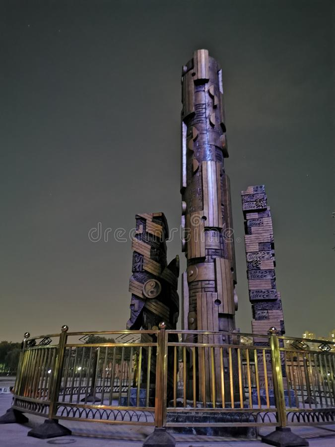 Three metal column-shaped artworks in shijiazhuang TV park, China. Shijiazhuang TV tower for all steel frame, built in January 1997, October 1, 2000 officially royalty free stock photos
