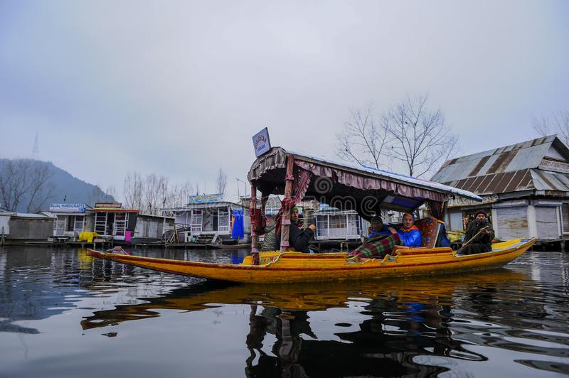 Shikara is one of the interesting activity that tourist can do in Kashmir. India during winter royalty free stock images