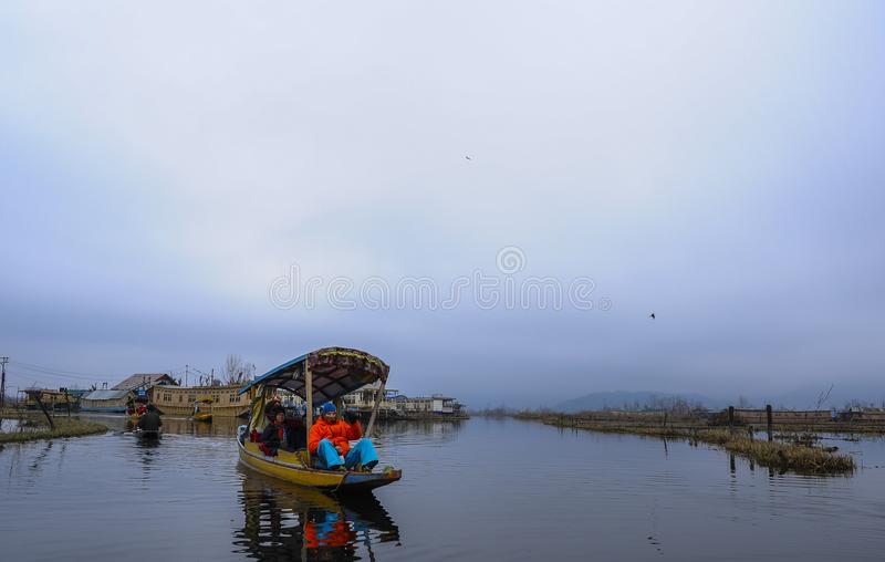 Shikara is one of the interesting activity that tourist can do in Kashmir. India during winter royalty free stock photography