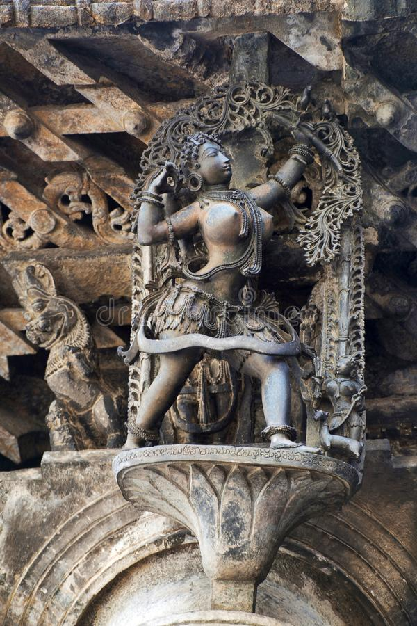 Shilabalika, celestial maiden, as a Huntress. Lady aiming arrow at the bird. Chennakeshava temple, Belur, Karnataka. Notice the ha. Shilabalika, celestial maiden stock photos
