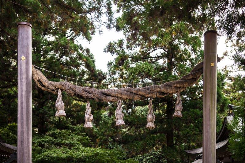 Shimenawa sacred rope at Omiwa shrine, Nara, Japan. Shimenawa sacred rope at Omiwa shrine in Sakurai, Nara, Japan stock photos