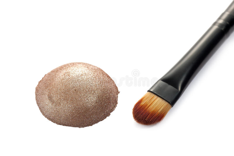 Shimmer eye shadow. Shimmer eyeshadow with brush on white background royalty free stock photos
