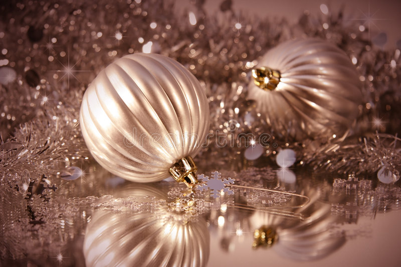 Shimmering frosted balls. With tinsel for Christmas decoration royalty free stock images