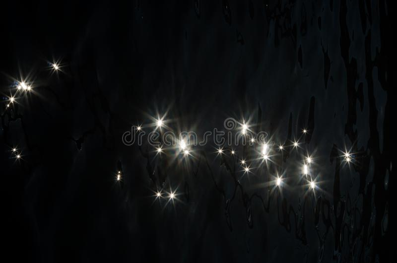 Shimmering reflections on the sea surface. They look like stars royalty free stock photos