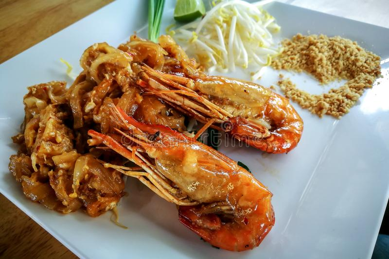 Shimp or prawn with padthai noodle Thai food style. Closeup to shimp or prawn with padthai noodle Thai food style stock photos