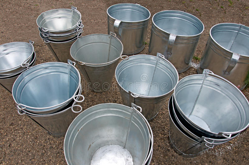 Shine of draw-well buckets. Selling of new and attractive handmade draw-well buckets on a village fair stock photo