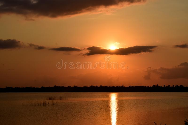 Shine like a sun. The sun rise reflection on a waterway with orange effect royalty free stock photo