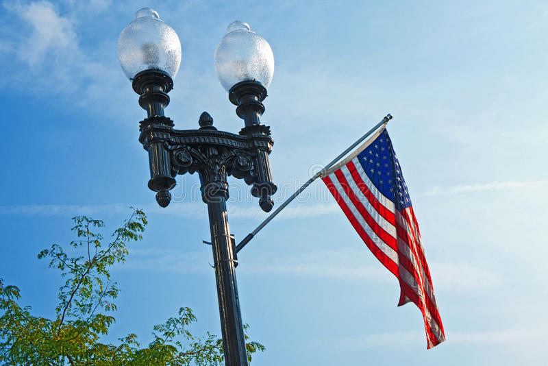 Shine On, United States Flag. Lamp post with United States flag in Lawton, Michigan royalty free stock image