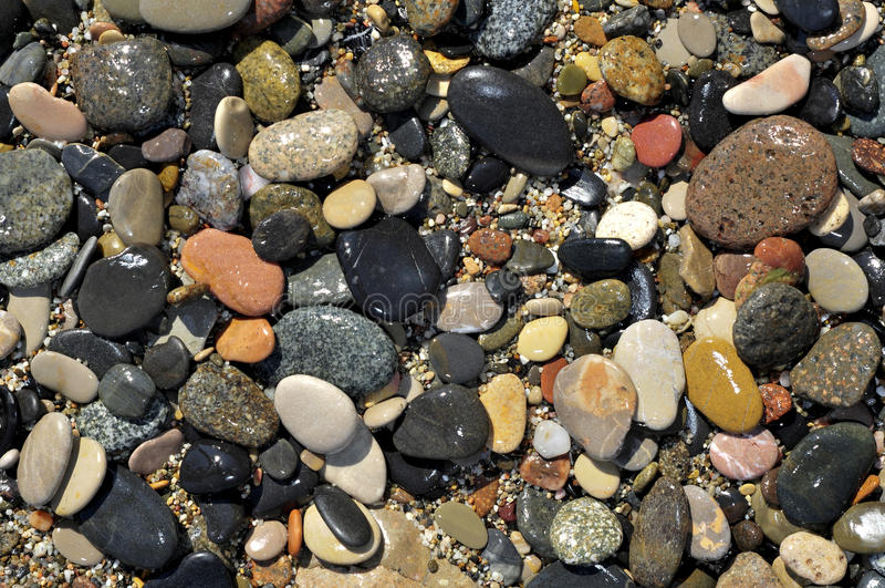 Shingle beach. Closeup of a shingle beach, with pebbles, gravel and sand stock image