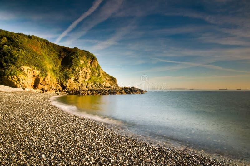 Shingle Beach. Waves breaking on a shingle beach in Cornwall, UK royalty free stock photography